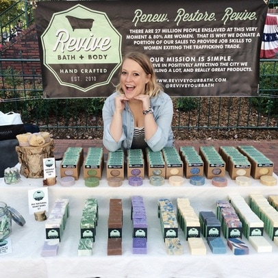 Caitlin Abshier at a farmer's market selling Cait + Co soap